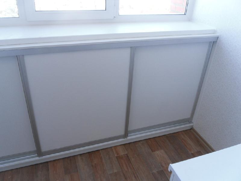шкафчики под окном на балкон фото